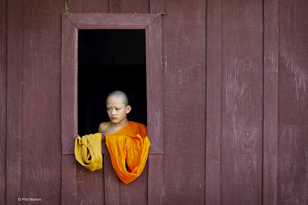 Photograph Novice monk candid - Laos by Phil Marion on 500px