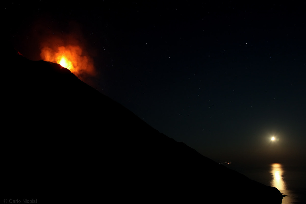 Photograph Eruption under the Moon by carlonic on 500px