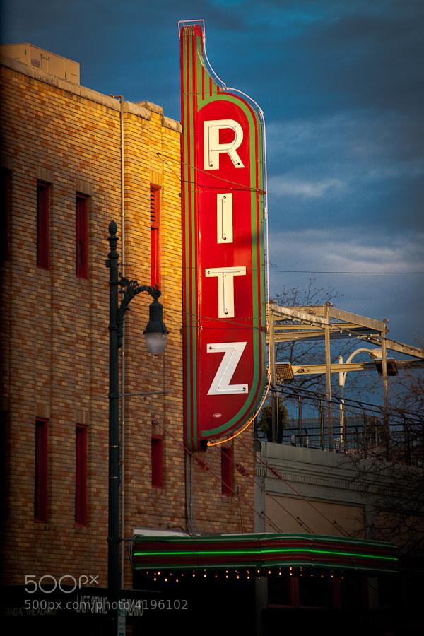 The sun setting on the Alamo Draft House Ritz Theater on Sixth Street in Austin