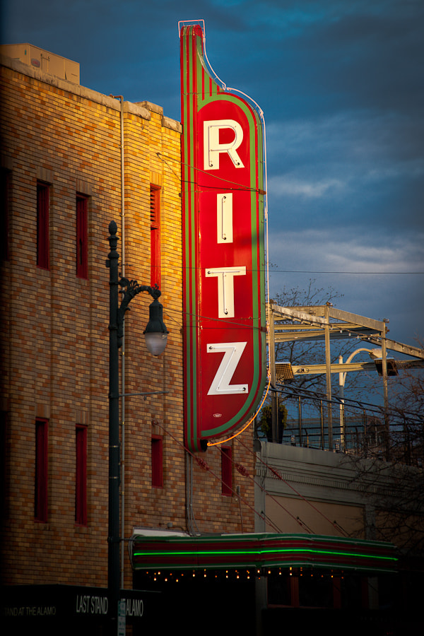 The sun setting on the Alamo Draft House Ritz Theater on Sixth Street in Austin