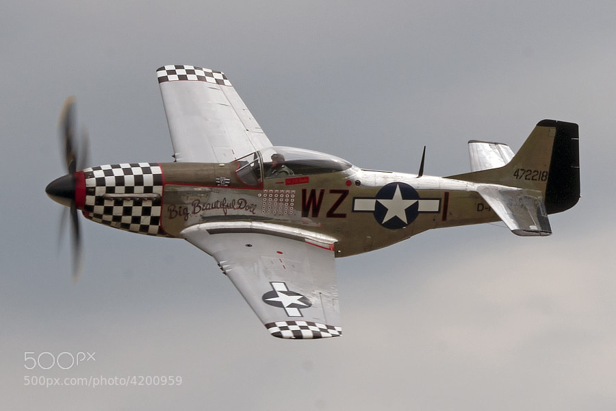 This photo was taken at the 2011 Duxford Legends air show in Duxford, England.  Later in the day, after this photo was taken, this P-51 was involved in a mid-air collision with a Skyraider aircraft. The P-51 crashed, but the pilot was able to parachute to safety before the crash.