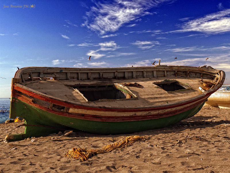 Photograph Beached boat by Jose A. Jerez on 500px