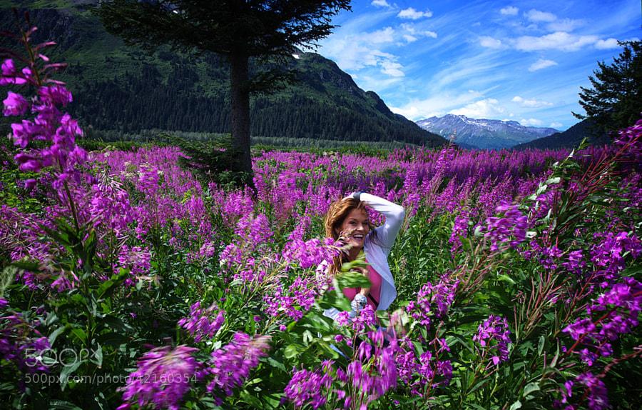 Valerie in a field of blooming Fire Weed near Seward, Alaska.