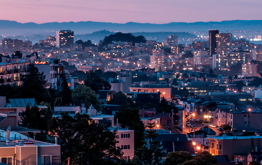 View of illuminated San Francisco at dusk taken from Upper Noe Valley looking north toward Pacific Heights and the North Bay