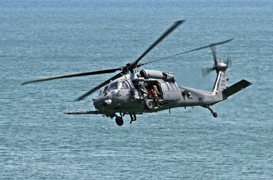 HH-60G Pave Hawk somewhere over the Atlantic Ocean.  Note the SEAL Team ready to deploy.