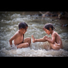 These two girls were taking a bath in the river near a remote Flower H'mong village in North Vietnam.