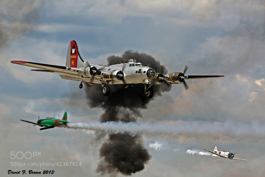 The Tora, Tora, Tora portion of the Air Venture Air Show was totally sick.  This scene strives to recreate the arrival of a B-17 Flying Fortress at Pearl Harbor on 7 December 1941 which arrived in the middle of the surprise attack.  The Japanese Navy planes depicted are not genuine, they are replicas constructed from surplus World War Two trainer aircraft.