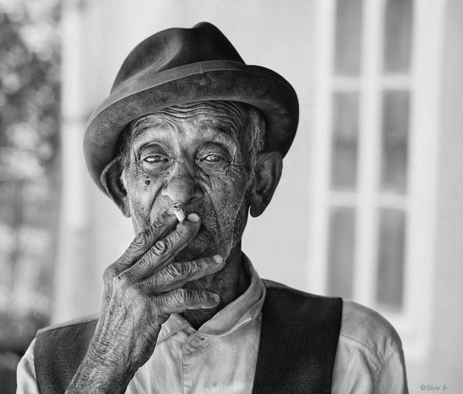 Photograph An old man with cigarette by Silvia S. on 500px