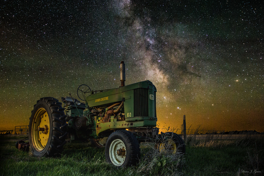 """Farming the Rift III"" ----  Milky Way, Stars and Airglow shine bright on a dark South Dakota night over this old John Deere tractor. Tractor is illuminated using a flashlight and the greenish waves of color in the sky are known as airglow, which was very visible on this particular night.   <a href=""www.homegroenphotography.com"" rel=""nofollow"">www.homegroenphotography.com</a>  <a href=""http://www.facebook.com/HomeGroenPhotography"" rel=""nofollow"">www.facebook.com/HomeGroenPhotography</a>"