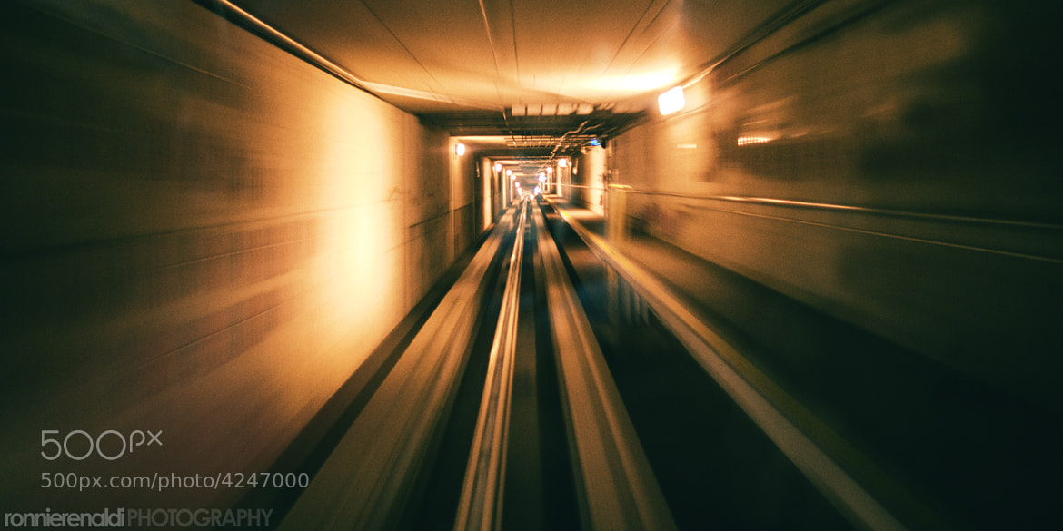 Photograph Denver International Airport Tunnel by Ronnie Renaldi on 500px