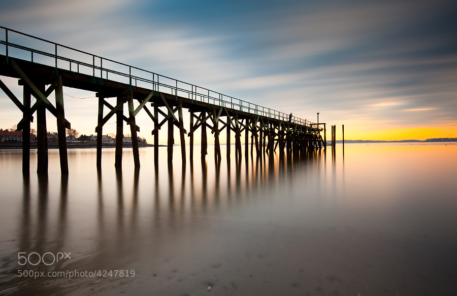 Sunset by a pier in Swampscott, MA