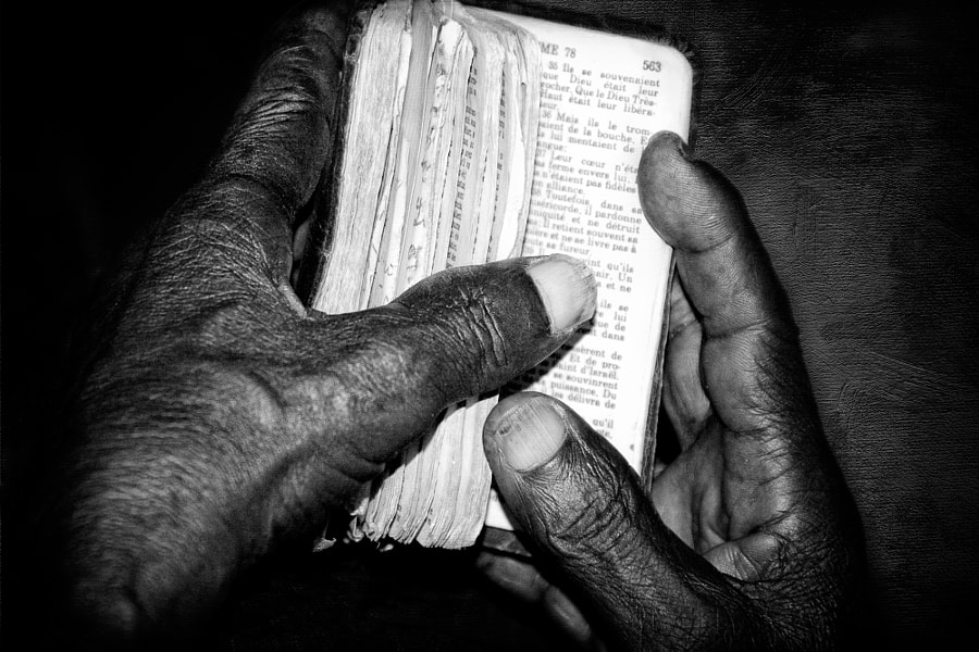These hands belong to a 78 year-old Haitian man who lives in Ouanaminthe, Haiti. He had been losing his sight and attended a medical clinic where glasses and eye care were being provided. This picture is at the moment he received glasses and was able to see and read clearly which he had not been able to do for many years. The very first thing he reached for was his well-worn but highly treasured bible.
