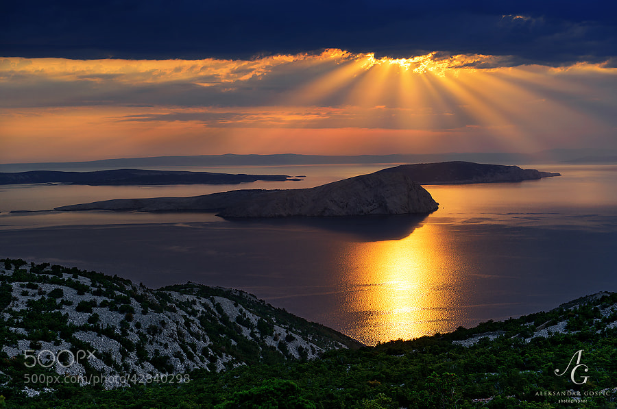 After a long series of clear and hellishly hot days, with temps that exceeded 40°C in some parts of Croatia, change finally came.  Looking at Velebit channel and Goli Otok (Naked/Barren Island) from the slopes of Velebit mountain. Behind are islands of Rab, Cres and Grgur