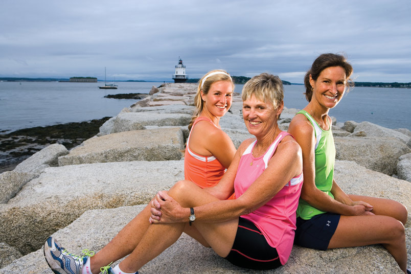 Participants in the Tri for a Cure pose near the starting line at Spring Point Light in South Portland, Maine.
