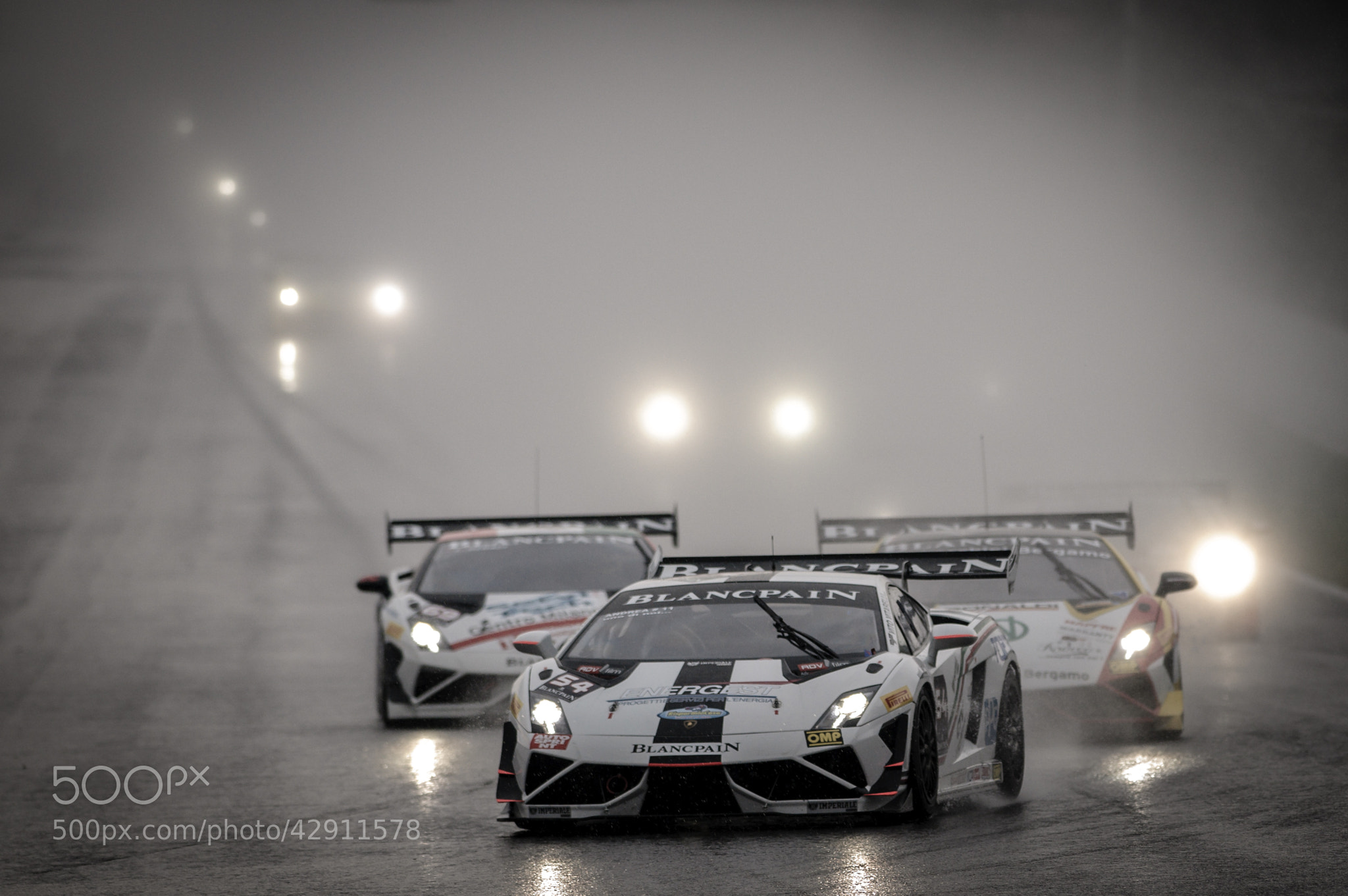 Photograph Racing in the rain by blank_re on 500px