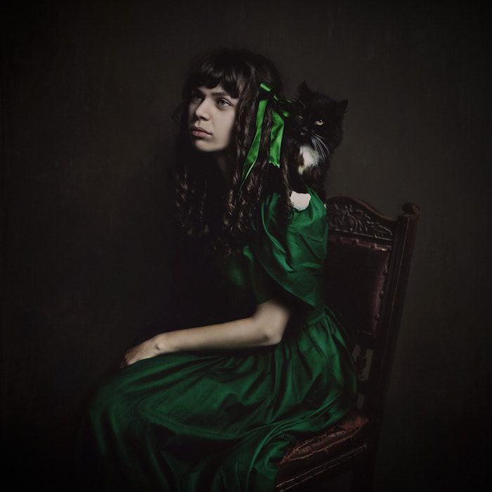 a portrait of a girl and her cat by Rosie Anne Prosser on 500px.com