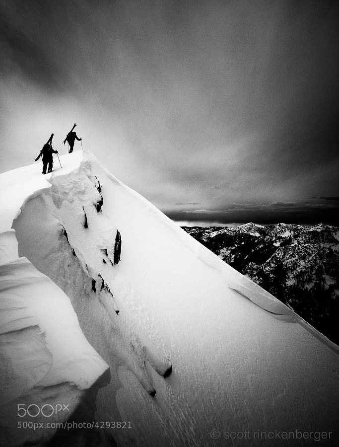 Two skiers cresting the north ridge of Kendall Peak in the Cascade mountains of Washington State.