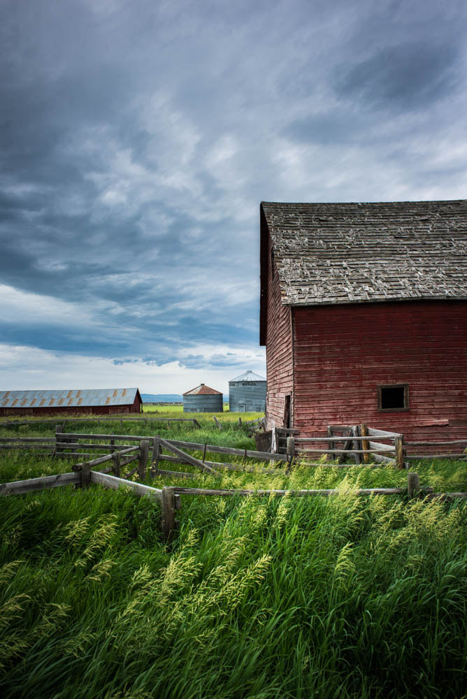 Photograph Epic clouds outline a barn in Bozeman, MT by Lauren Coleman on 500px
