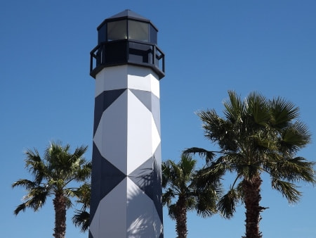Photograph Kemah Tx lighthouse with palm trees by Shirley Johnson on 500px