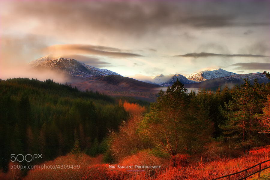 a view of Nevis Range from Loch Laggan