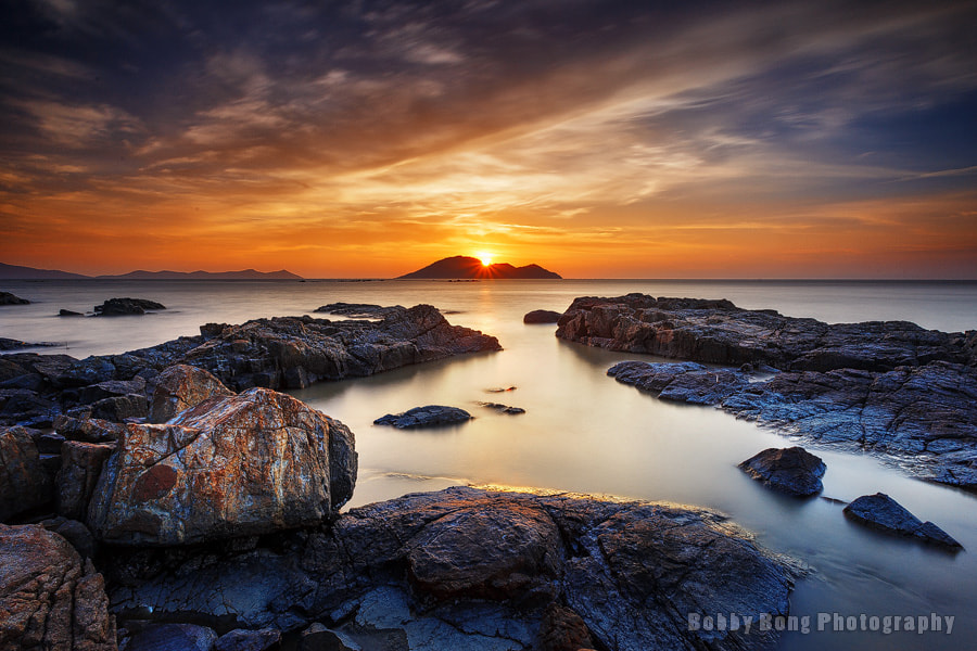 Photograph Sunburst above Kabung Island by Bobby Bong on 500px