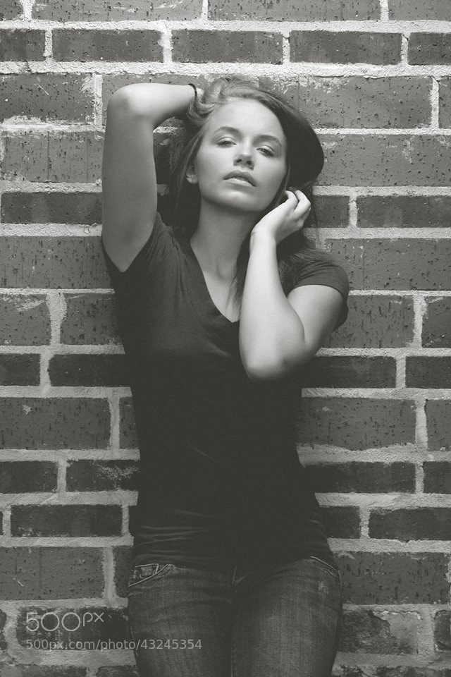 Photograph Claire on brick wall by Justin Lister on 500px