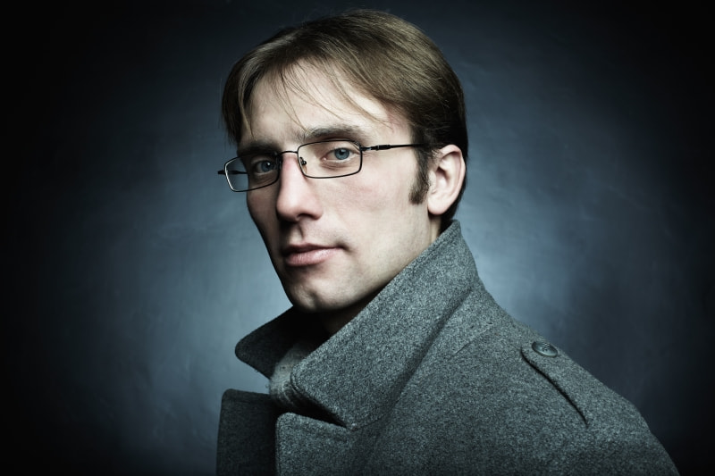Artistic dark portrait of the young beautiful man in a gray coat by Oleg Gekman on 500px.com