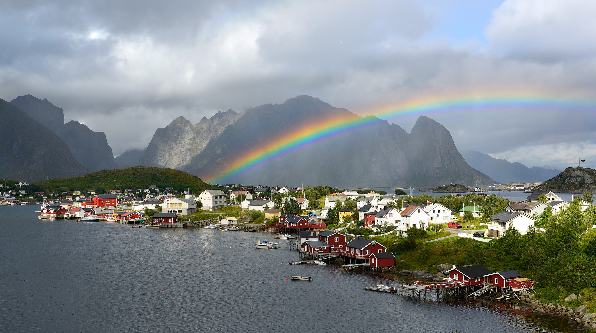 Photograph The rainbow over Reine by Andre Ermolaev on 500px