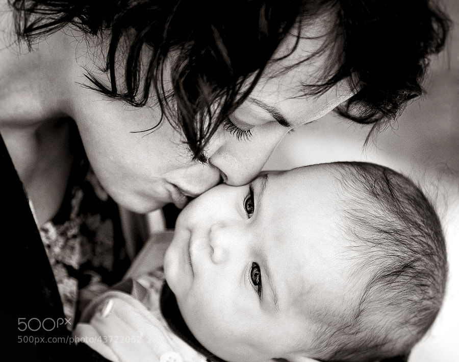 A mother loves her 4 month old daughter...