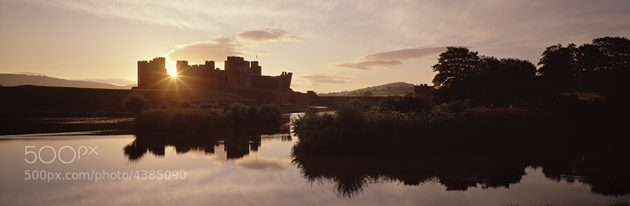 CAERPHILLY CASTLE AT DAWN.SOUTH WALES.DAWN