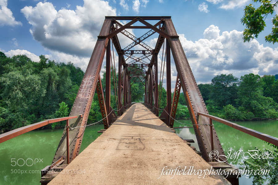 The old railroad bridge crosses the west fork of the Little Red River in Shirley, Arkansas, in Van Buren County in the Ozark Mountains.