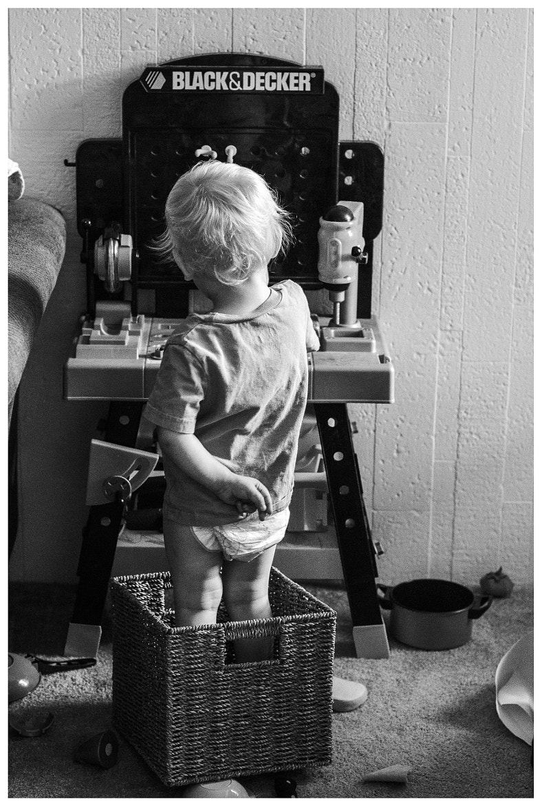 Photograph Ben standing in a box at the work bench by Michael Hocter on 500px