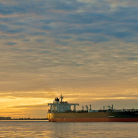 The tanker, Ice Explorer, inbound to Texas City, Tx with an awesome Sunrise as a backdrop
