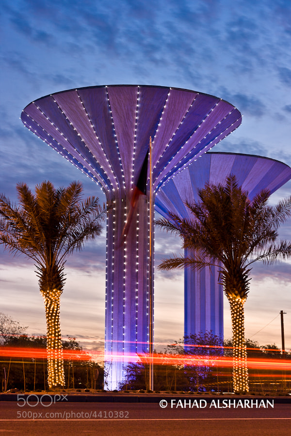 Water towers in Ahmadi city are decorated with sparkiling lights to celebrate independence day of Kuwait (with raised flag in center of photo).