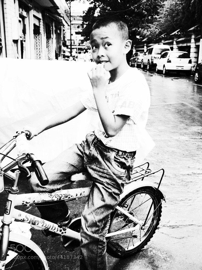 Photograph The boy on the bike by Zhu RenYan on 500px