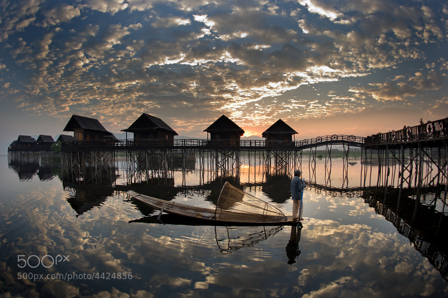 Mirror - Inle Lake and its water chalets in the early morning