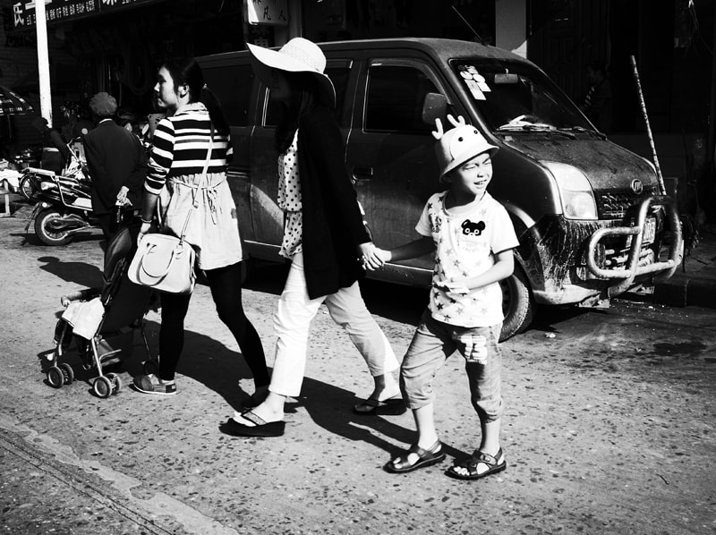 Photograph Mother Holding Her Child's Hand on Yuchi Road by Zhu RenYan on 500px
