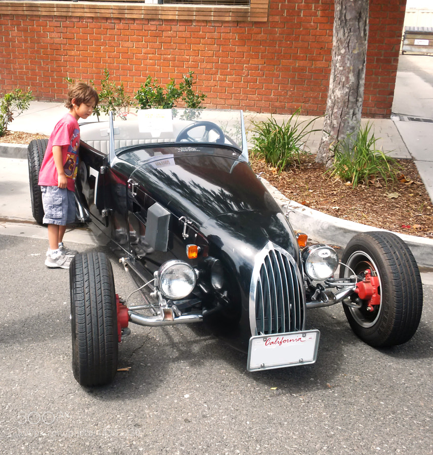 A early American street rod.  Will the boy jump in and take it for ride?