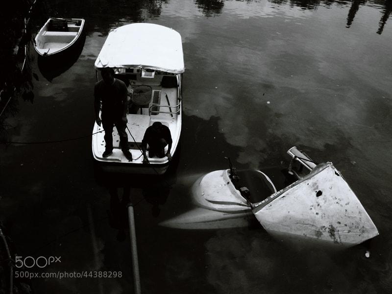 Photograph Raising a sunken boat at the Green Lake Park in Kunming,Yunnan,China by Zhu RenYan on 500px