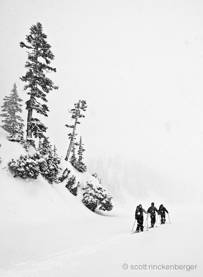Cossing Snow Lake in the central Cascades during a heavy winter storm.