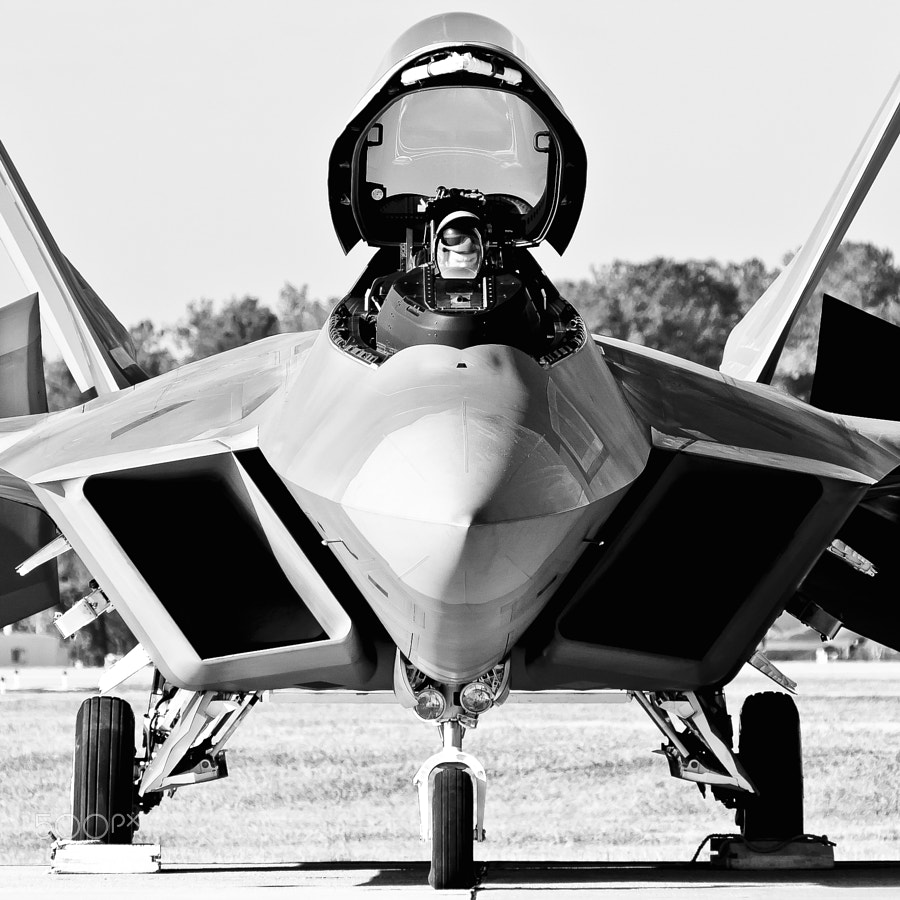 "The morning dew is running down the nose of the Raptor as Maj Paul ""Max"" Moga pre-flights the F-22A for a practice flight"