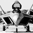 """The morning dew is running down the nose of the Raptor as Maj Paul """"Max"""" Moga pre-flights the F-22A for a practice flight"""