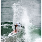 Постер, плакат: A professional surfer participating at the US Open of Surfing ASP event and Vans Off The Wall event