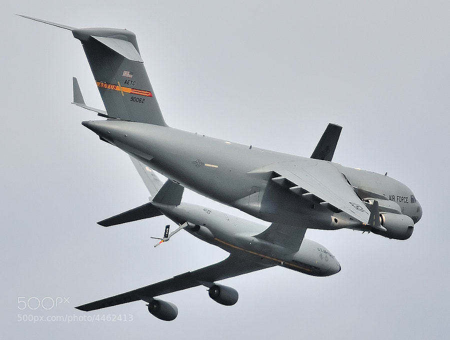 U.S. Air Force C-17 and KC-135 Demo Teams perform a crossover break maneuver at the end of their demonstration