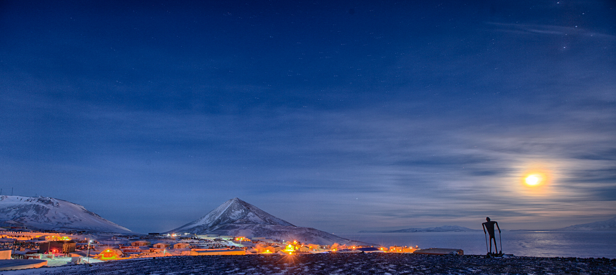 Photograph Full Moon and Skier over McMurdo by Deven Stross on 500px
