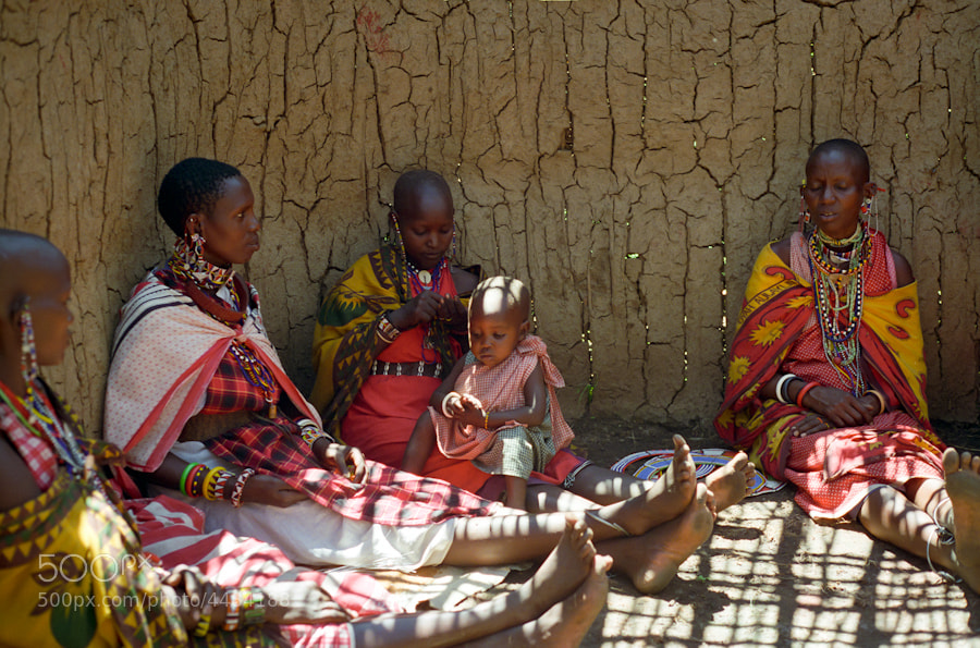 Photograph Masai ladies relaxing in mid day sun (Jan 1994) by Jeff Goldberg on 500px