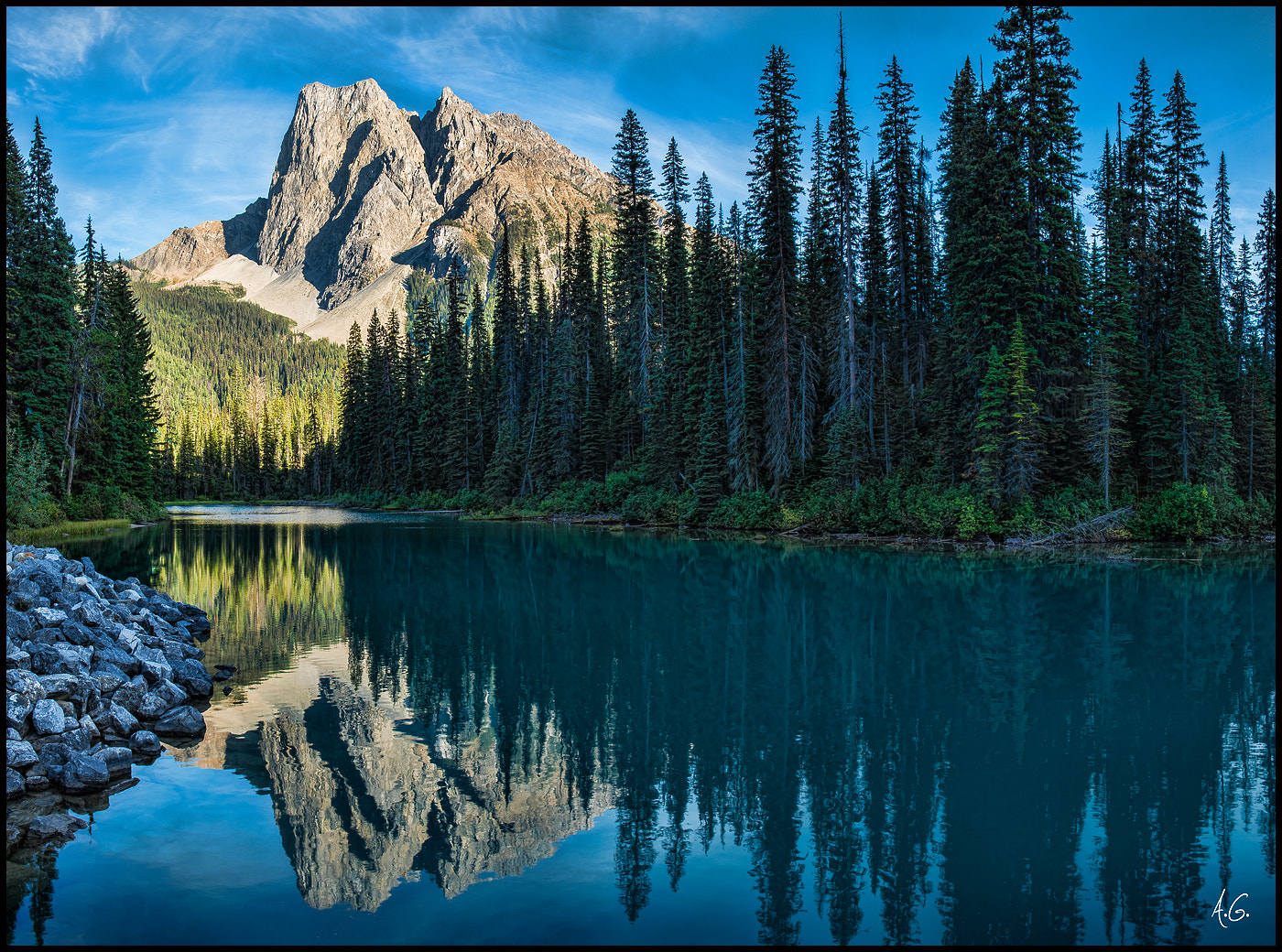 Photograph Reflections of Emerald Lake by Alex Gubski on 500px