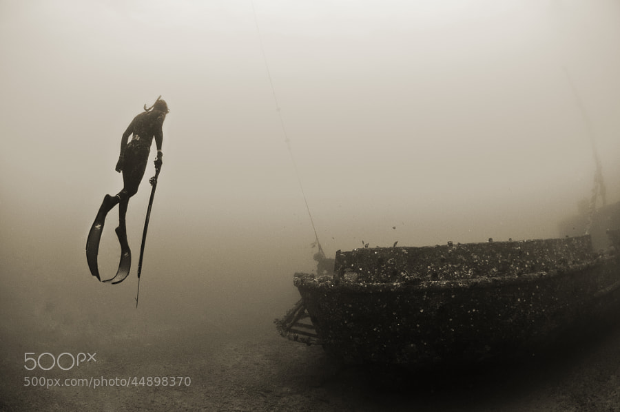 Photograph Free diver acsends from wreck by Kevin Boutwell on 500px