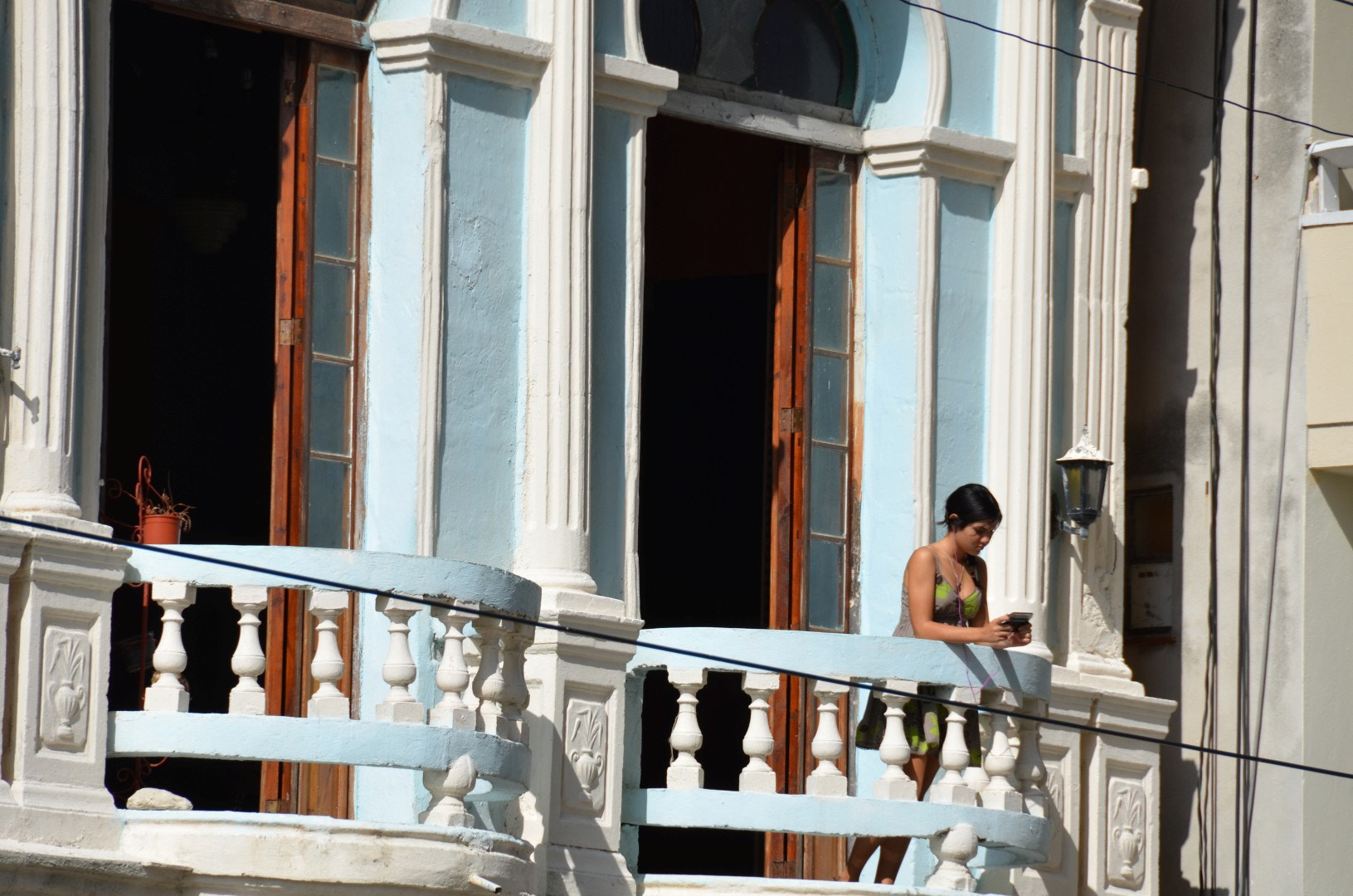 Photograph Girl on balcony by Alexander Ortweiler on 500px