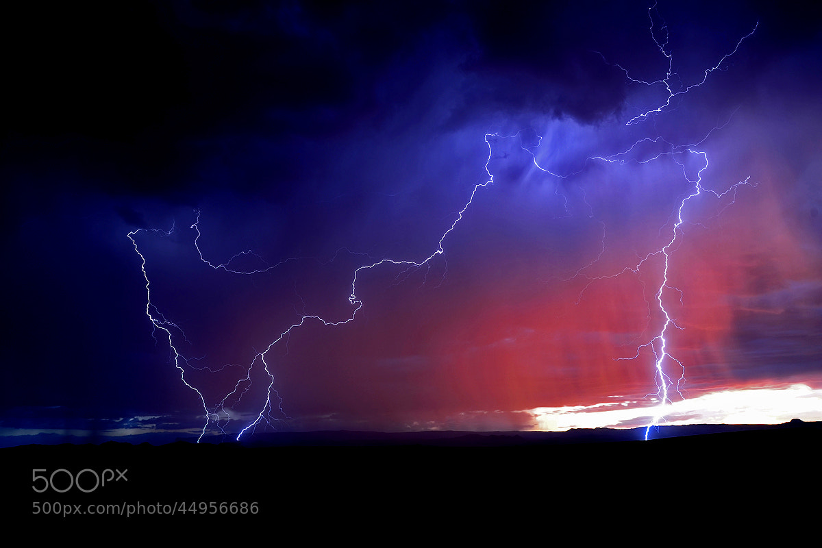 Photograph Thunderstorm and red clouds by Michael Hubrich on 500px
